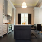 Additional image of modern kitchen featuring an custom marble island countertip and cabinetry.