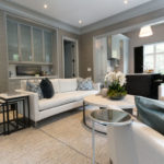Additional image of modern living room featuring white sofa, chairs and coffee tables.