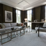 Additional image of a modern living room with glass tables, custom bookshelves and area carpet.