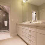 Picture of modern bathroom with separate shower area.