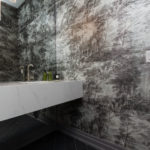 Photo of modern bathroom with floral wallpaper