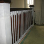 Image 2 of banister railing during refinishing