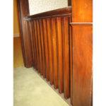 Image 1 of banister railing before refinishing